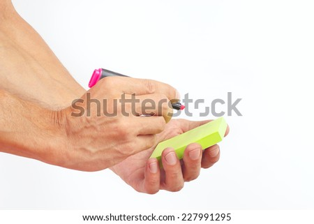 Hand written notes in red marker on a green sticker on a white background - stock photo