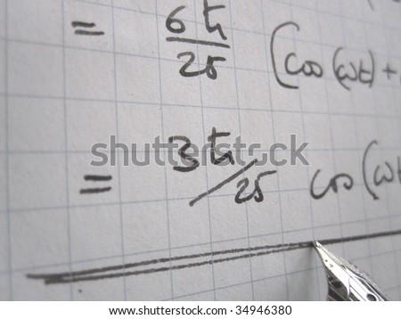 Hand written physics calculations on quantum mechanics - stock photo