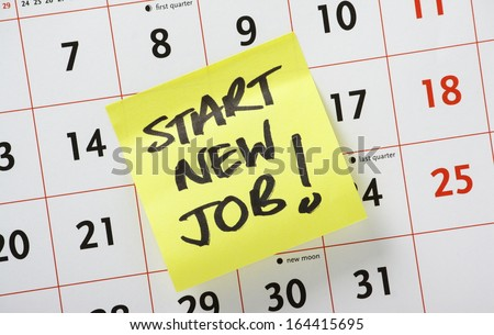 Hand written reminder to Start New Job on a yellow post it note stuck to a calendar background - stock photo