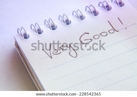 "Hand writting text ""Very Good"" on a white page"