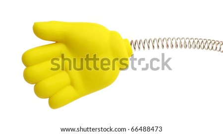 Hand yellow rubber on spring - stock photo
