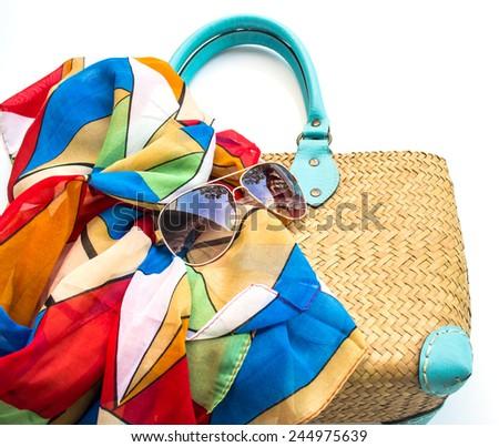 Handbag,scarf and sunglasses on white background - stock photo