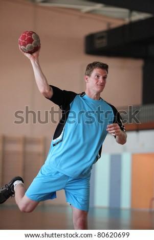 handball player is shooting - stock photo