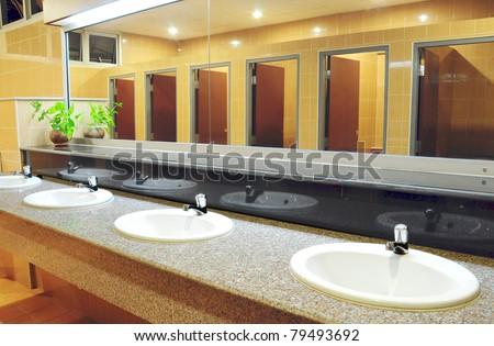 office washroom design. handbasin and mirror in toilet office washroom design