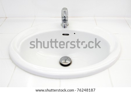 Handbasin in toilet - stock photo