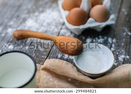 handcarved wooden spoon and cooking a sweet pie - stock photo