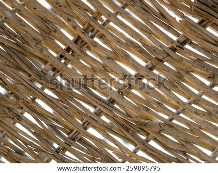 Handcraft of wicker pattern for your decoration background. Woven wooden wicker fence panel for the hand crafts, gardening background or wallpaper pattern.  Textured background with wickerwork panel. - stock photo
