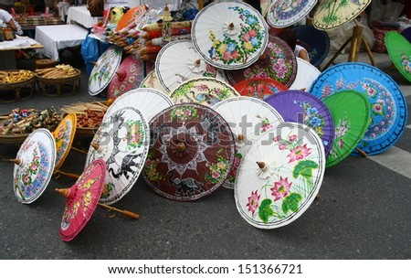 handcraft paper umbrella with paint color , umbrella shop, travel in Chiang Mai ,Thailand  - stock photo