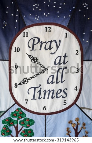 "Handcraft with wording ""pray at all times"" for house decoration - stock photo"