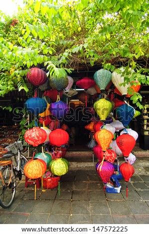 Handcrafted lamp in ancient town Hoi An, Vietnam. Hoi An is a famous tourist destination of Vietnam, with old houses from the 16th and 17th centuries. - stock photo