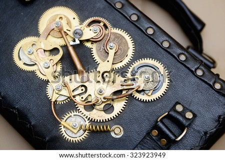 Handcrafted leather bag with Steampunk mechanisms - stock photo