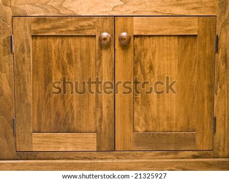 Handcrafted wood cabinet doors - stock photo