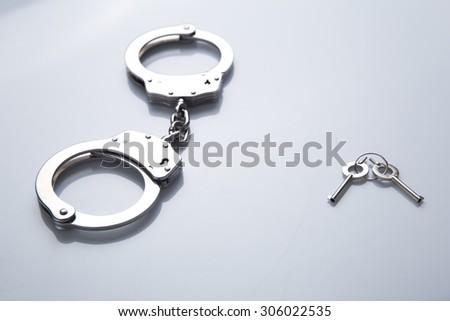 Handcuff and keys - stock photo