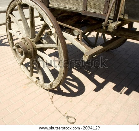 handcuff attached to a wagon wheel as used  in the old time, Montana, USA - stock photo