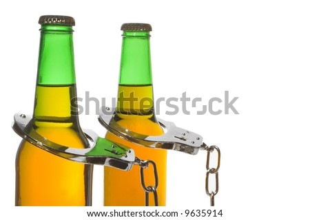 Handcuffed Beer - Drunk Driving Concept - stock photo