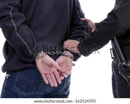 Handcuffed man being escorted by the policeman - stock photo