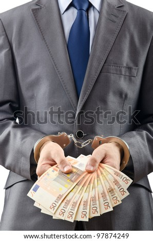 Handcuffed man with euro banknotes - stock photo