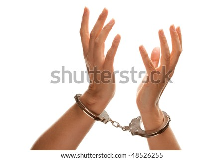Handcuffed Woman Desperately Raising Hands in Air Isolated on a White Background. - stock photo