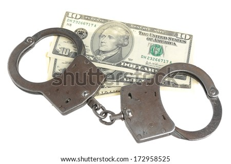 Handcuffs and dollars isolated