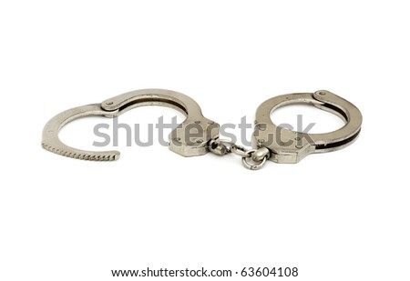 handcuffs are opened in the form of heart isolated on white background - stock photo