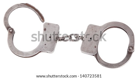 handcuffs closeup, isolated background - stock photo