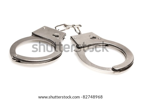 Handcuffs isolated on white background with shadows