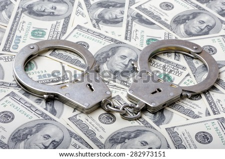 Handcuffs on a dollar banknotes