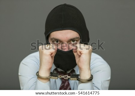 Handcuffs on hands of a businessman.