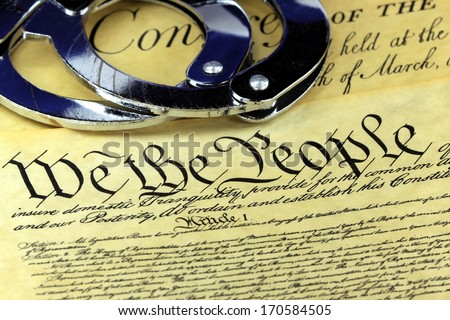Handcuffs on US Constitution We the People - Fourth Amendment - stock photo