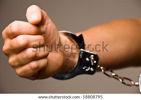 Handcuffs - symbol for crime - stock photo