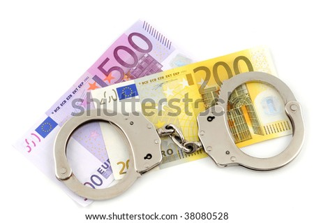 Handcuffs with key on white background - stock photo