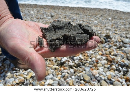 Handful of black sand