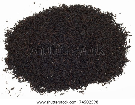 Handful of black tea leaves on white background