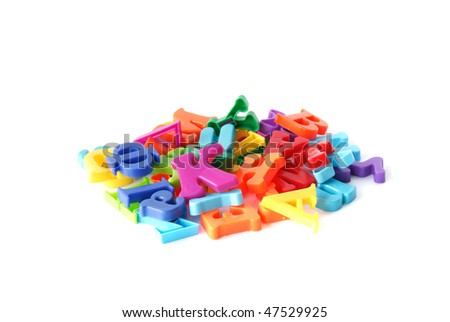 handful of colored plastic magnetic letters isolated on white background