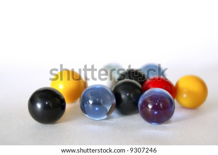 Handful of colorful glass marbles over white background. - stock photo