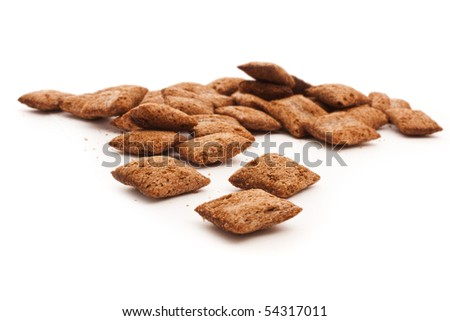 handful of corn cookies isolated on white