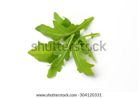 handful of fresh arugula leaves on white background - stock photo