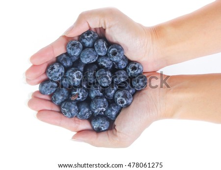 handful of freshly picked blueberries isolated on white