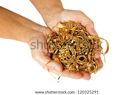 Handful of Gold Ready to Sell for Cash - stock photo