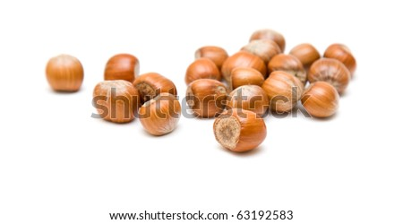 handful of hazelnuts isolated on white backgound