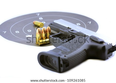 Handgun and bullets on white background - stock photo