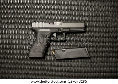 Handgun and Magazine - stock photo
