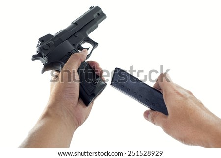 handgun changing a magazine - stock photo