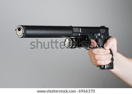 handgun in the hand - stock photo