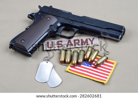 handgun on army uniform - stock photo