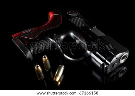 handgun on glass at night with red back lighting