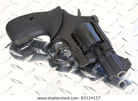 handgun that is a revolver with a snub nose barrel