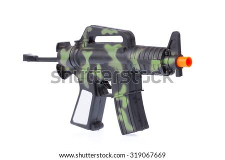 Handgun weapon crime gun toy isolated on white background - stock photo