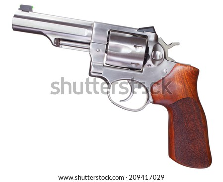 Handgun with a stainless steel frame and wood grips - stock photo
