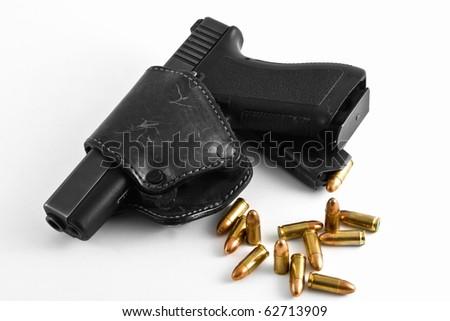 handgun with holster and shots - stock photo